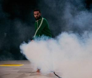 Emile putting smoke in the space with a big smoke machine