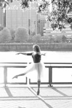 Ballerina jumping, black and white photograph taken at the Portland Waterfront