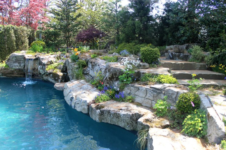 Waterfall into pool showing Landscape and Pool Design NY Area