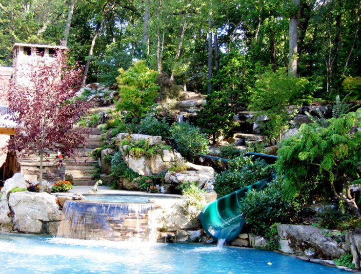 Waterslide and jacuzzi showing Landscape and Pool Design in NY Area, waterfall, natural swimming pond, rock gardens