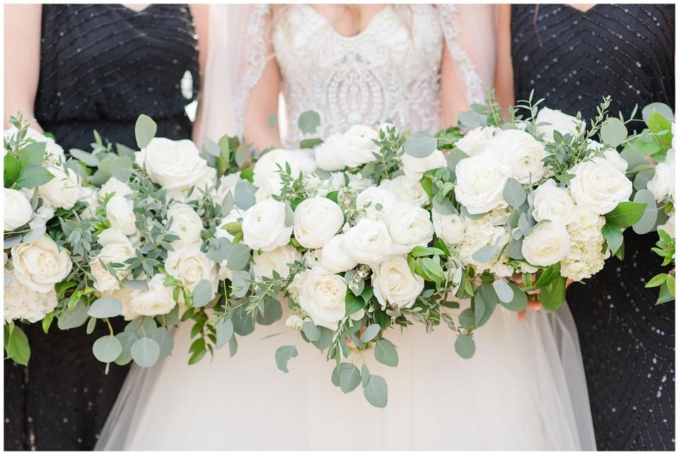 cream greenery bride and bridesmaid bouquets for winter wedding