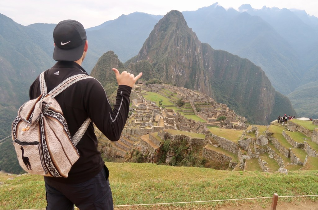 Dan modeling our llama backpack in Machu Picchu - tips and tricks for hiking to machu picchu