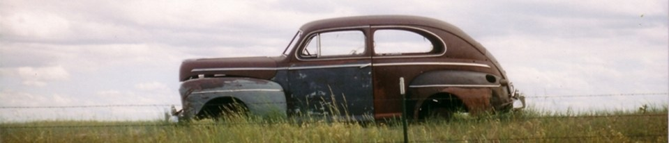 old car in the grasslands