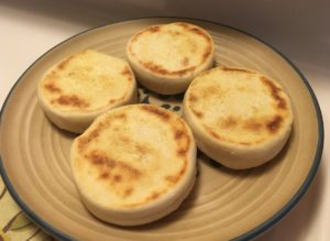 four English muffins on a plate