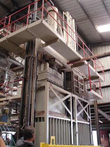 Hydraulic presses mash the ginned cotton into bales