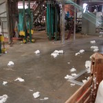 Scraps of cotton litter the floor inside the gin