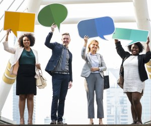 people of diverse ethnicities holding word bubbles over their heads