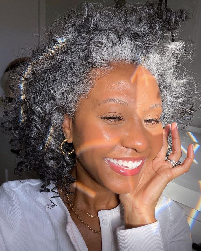 Youthful looking black woman with gray hair