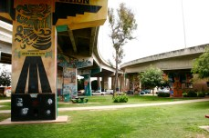 Chicano Park, San Diego, CA. After the bridge was built through the middle of their neighborhood, residents in the Logan Heights neighborhood petitioned for a park of their own in the 1960's. Chicano Park was built under the pylons of the Coronado Bay Bridge, but because they technically do not own the land, residents of the area constantly have to fight to keep it.