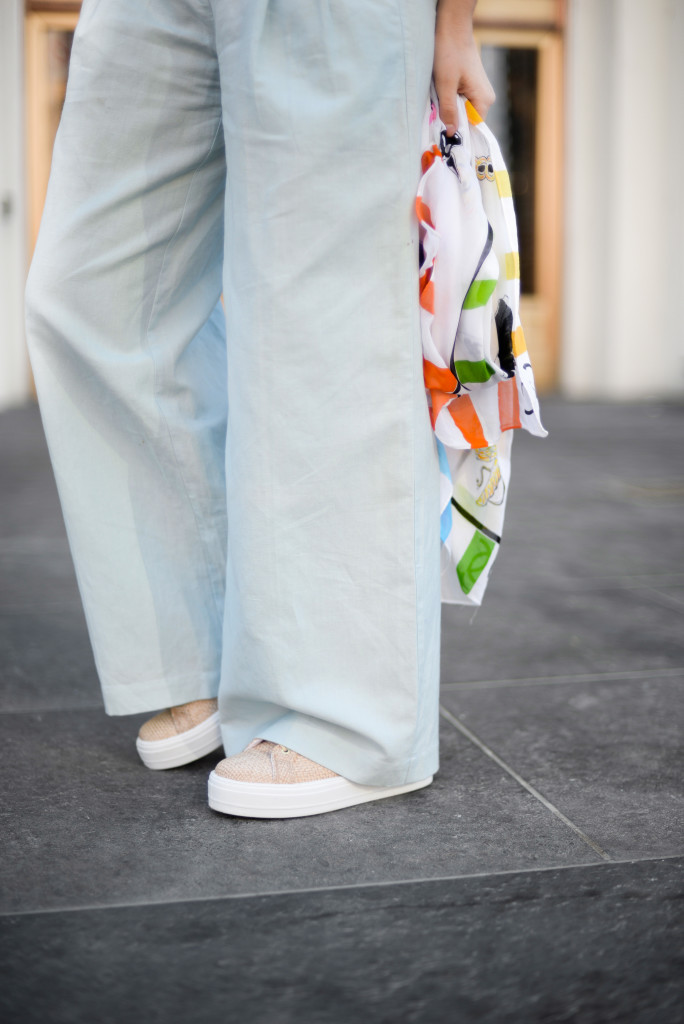 Wide legged pants and platform sneakers