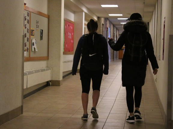 Students walk toward Saxe, Celani, and Herrig Halls, on the campus of Central Michigan University, Monday, February 27, 2017.
