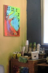 Kaya provides all the paper goods a customer could need, as well as display donated artwork such as the clock canvas.