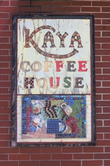 Kaya Coffee House sign still hanging outside of its previous location.