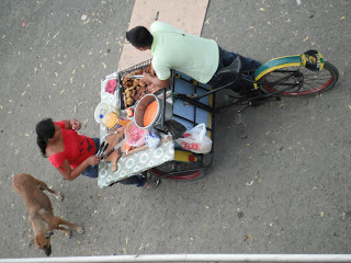 Dog with a food cart