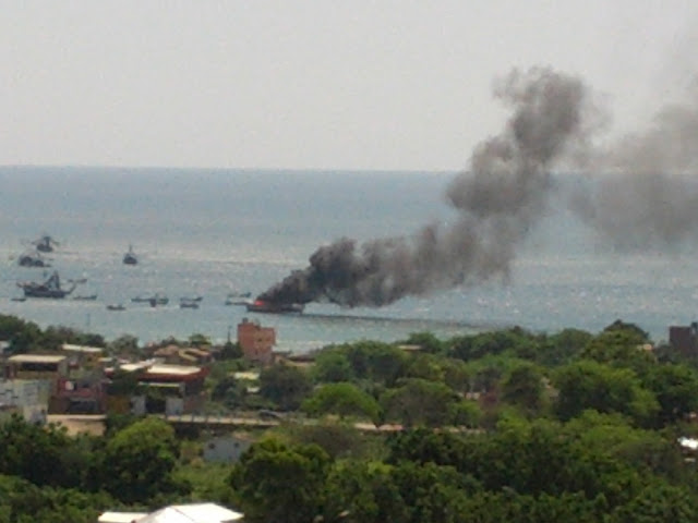 Boat burning in Puerto Lopez bay