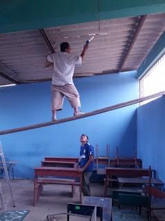 Angel repairing roof