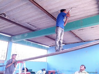 Augustine repairing roof