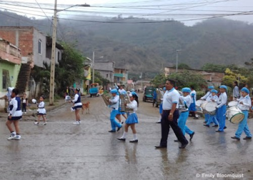 Parade participants in the wet streets