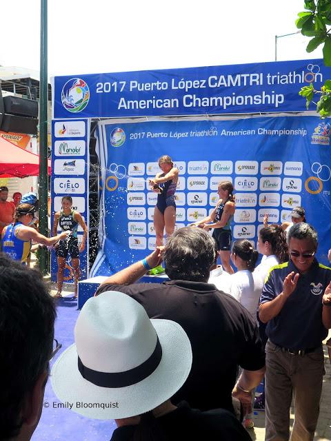 Sophie Chase celebrating triathlon win