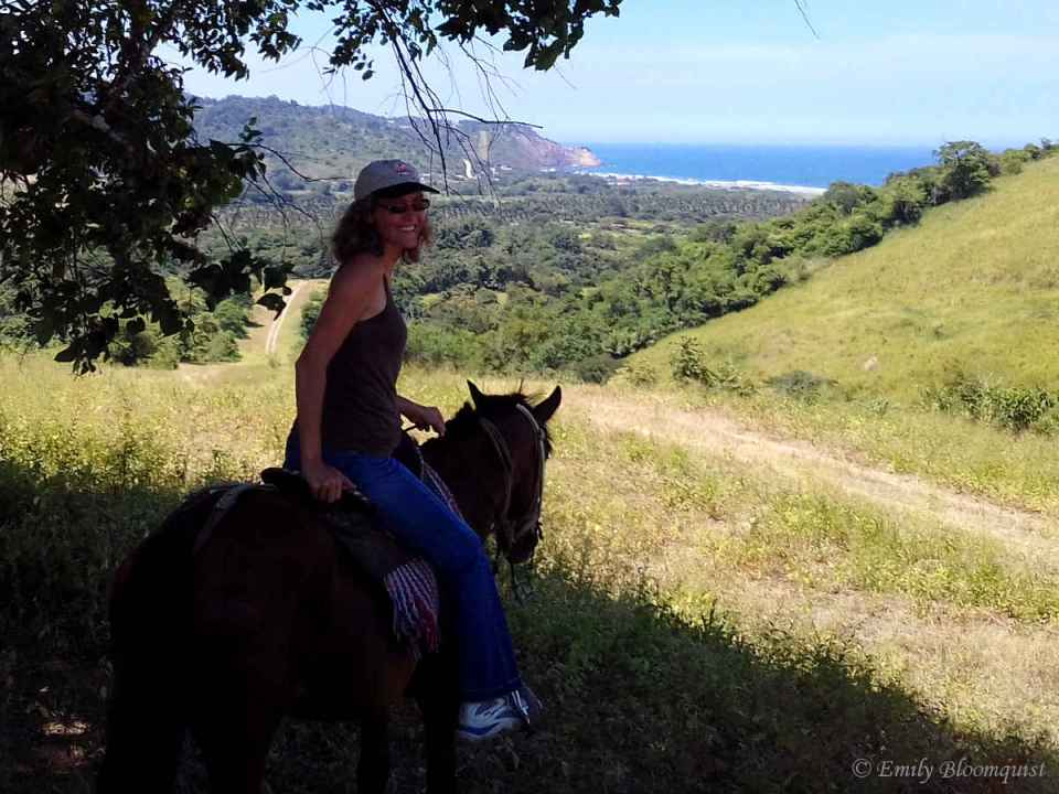 Horseback riding on hilltop with ocean view