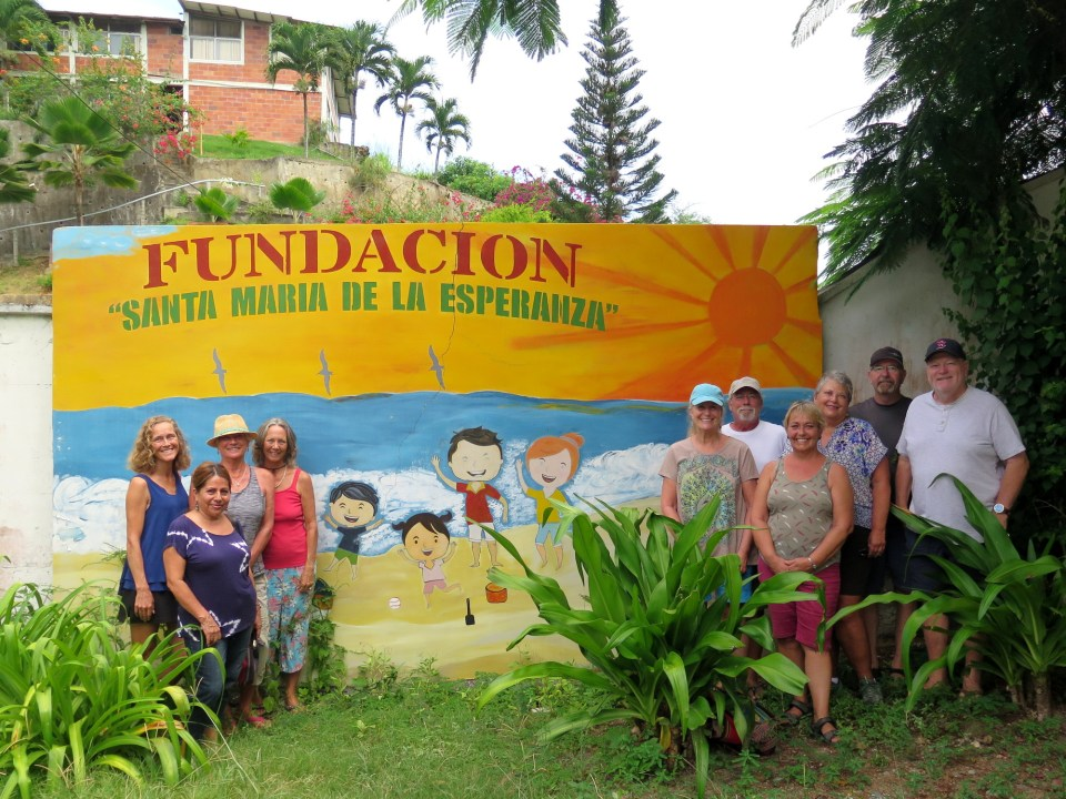 FOSMO board of directors in front of the orphanage