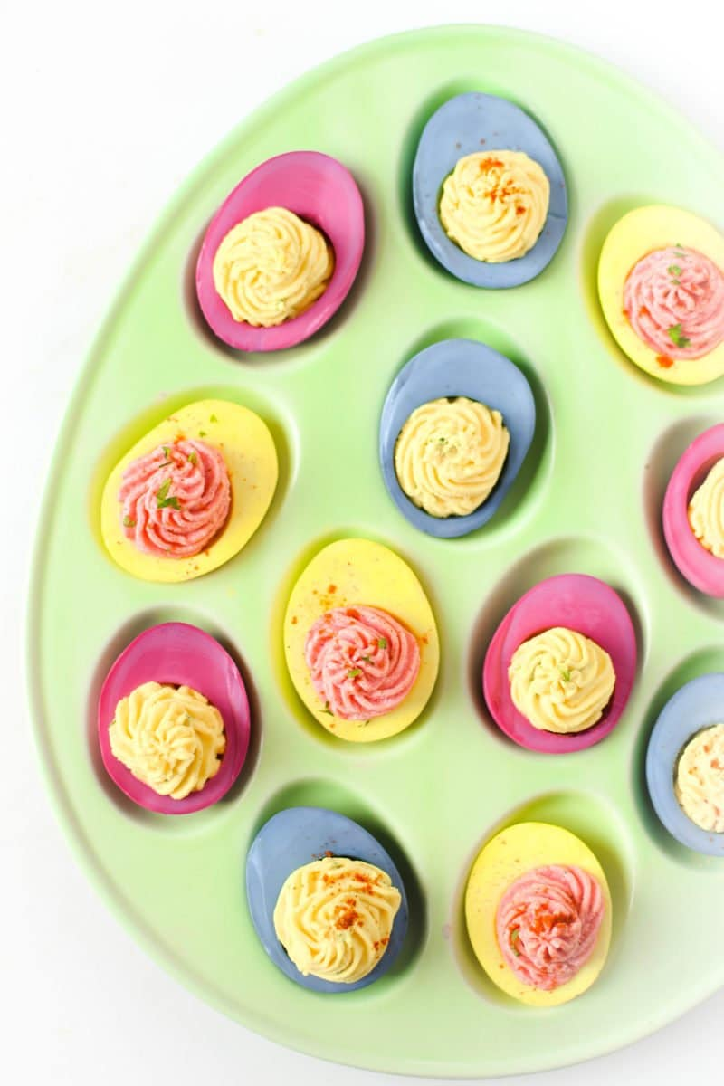 These beautiful Naturally Dyed Deviled Eggs are the perfect pretty appetizer for any holiday plus an excellent source of protein. Whether food dye allergies or intolerance are present in your family or not, everyone can benefit from making the switch to these all natural food dyes!