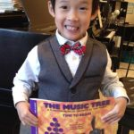 beginning piano student graduates from Time to Begin