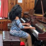 student performs at recital