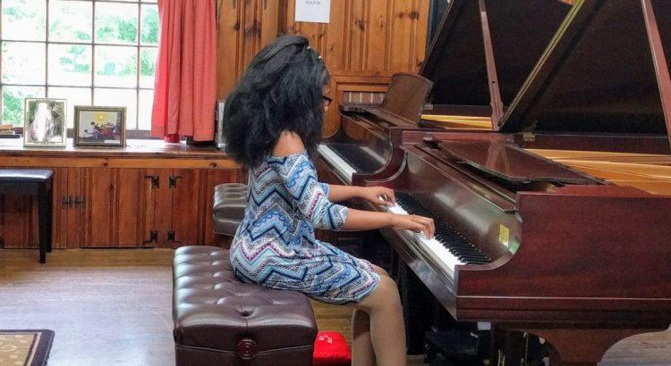 student performs at recital