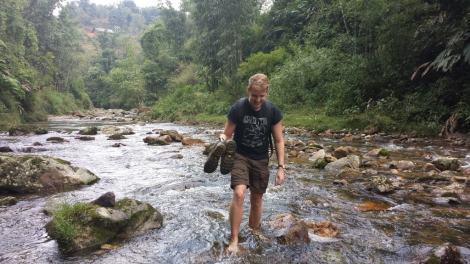 Sam tackling the river