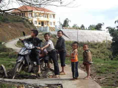 Local boys with their motorbike