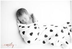 black and white newborn image, heart print swaddle blanket
