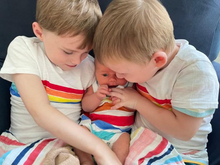 Emily P.G. Erickson's three sons wearing matching rainbow clothing.