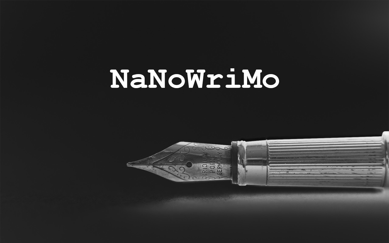 """The tip of a fountain pen with text """"NaNoWriMo"""""""