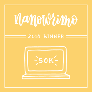 A laptop illustration with text: NaNoWriMo 2018 Winner