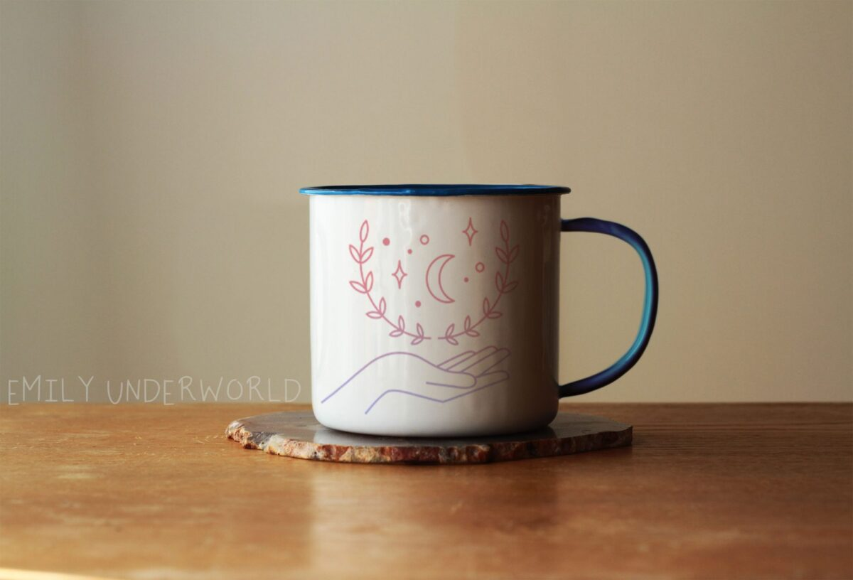 Picture of a mug featuring Emily Underworld blog design.