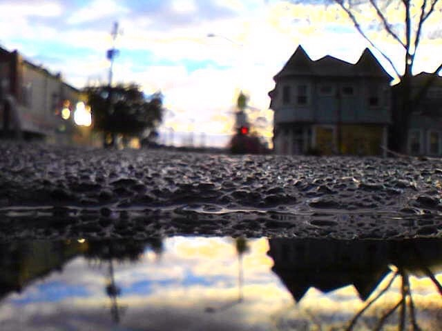 4770 Telegraph reflected in a puddle, Oakland, CA, 2016