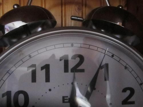 A close up of a white clock