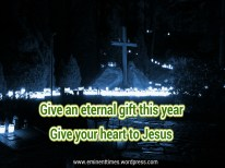 Cross_surrounded_by_hundreds_of_candles_at_Malmi_cemetery_on_Christmas_Eve-picsay