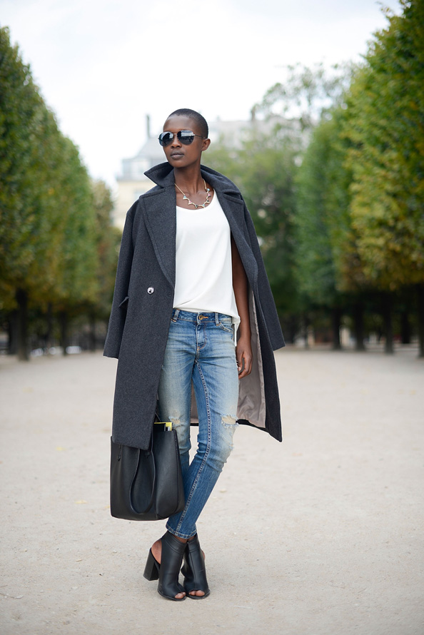 Aliane Uwimana takes simple high street to the next level wearing H&M coat, Zara shirt and pants, New Look shoes and Pull and Bear bag.