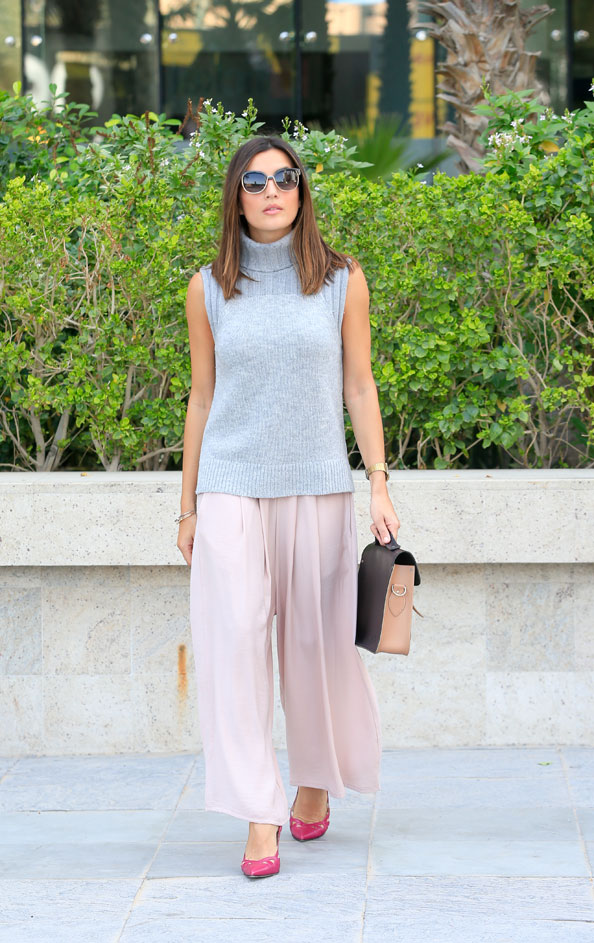 EW WEaring ALexandria Gouveia Armani Exchange polo neck, huda al Nuaimi trousers