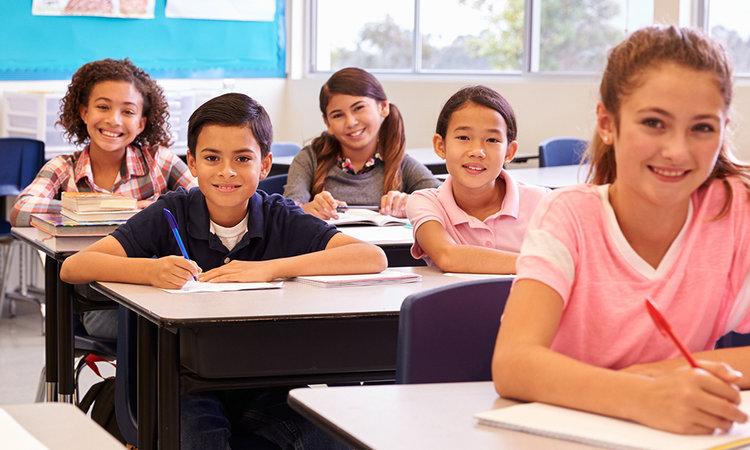 children sitting in desk at school