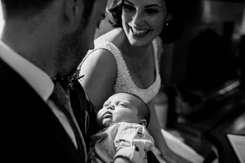 bride groom and baby