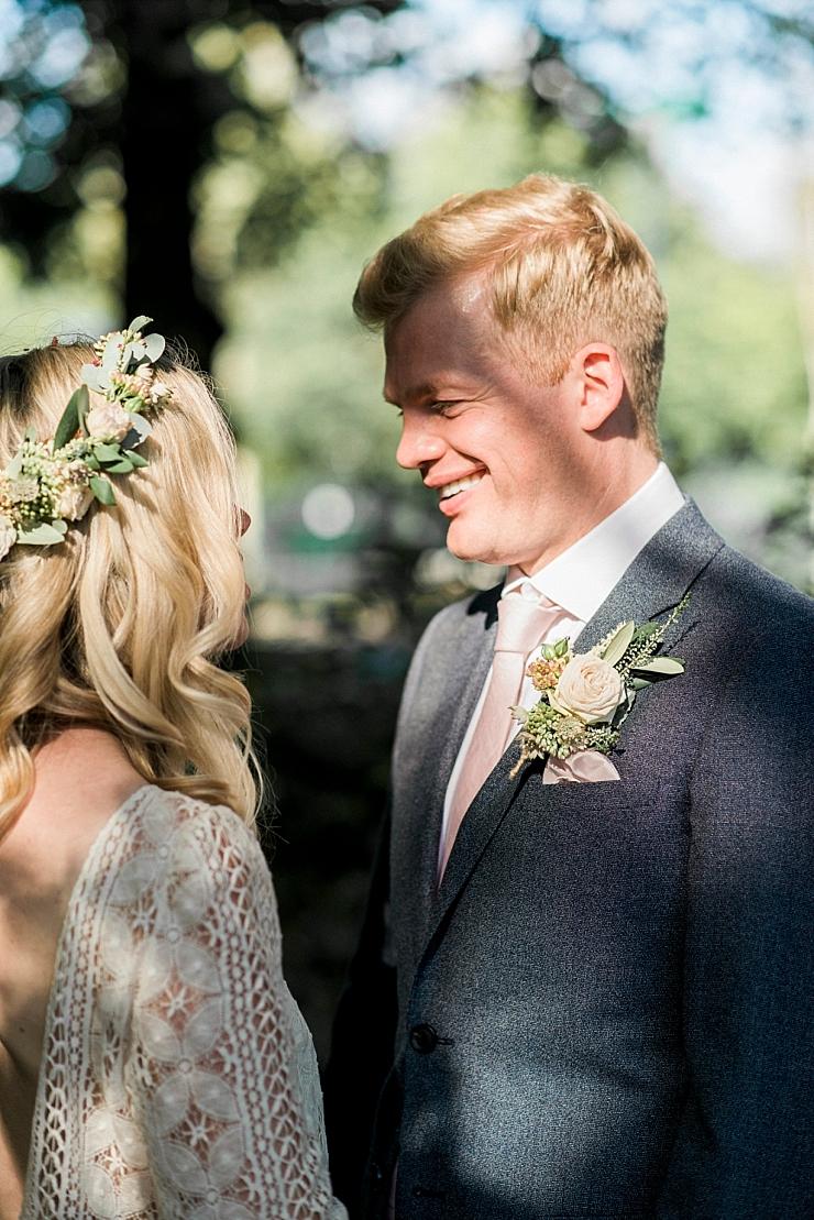 happy groom in sunlight