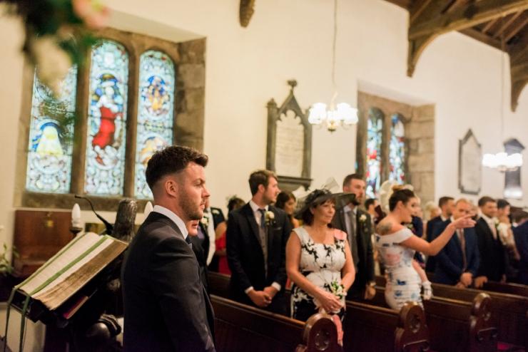 groom waits at church