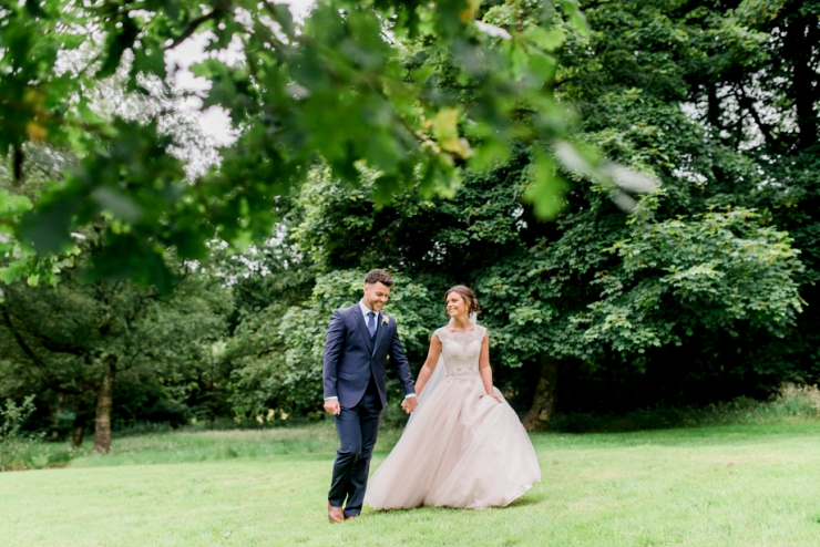 bride and groom on lawn