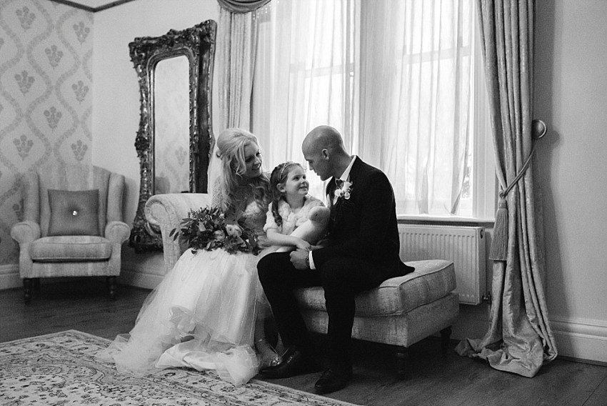 winter wedding at west tower with bride, groom and their little girl