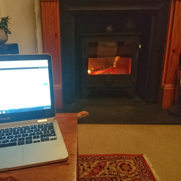 Laptop, in front of the woodburner