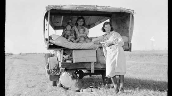 "A family traveling between Dallas and Austin, Texas. ""The people have left their home and connections in South Texas, and hope to reach the Arkansas Delta for work in the cotton fields,"" Lang wrote in her notes. ""Penniless people. No food and three gallons of gas in the tank. The father is trying to repair a tire. Three children. Father says, 'It's tough but life's tough anyway you take it.'"