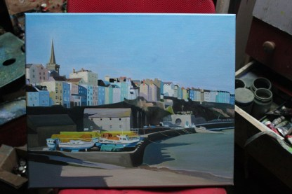An original oil painting of boats shored up for the winter at Tenby Harbour, West Wales.